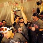 San Francisco's NLCS hero, Cody Ross, hoists the World Series trophy after the team's win in Game 5.  Claimed off waivers earlier in the season, Ross was just one of an unlikely group of Giants who thrived in baseball's October spotlight.