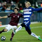 Rapids defender Kosuke Kimura (left) battles with FC Dallas midfiedler Brek Shea in the first half. Kimura had scored the goal that beat San Jose in the conference final, sending Colorado to the MLS Cup.