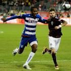 Rapids defender Drew Moor (right) fights for possession against FC Dallas striker Atiba Harris in the first half.