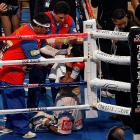 In his corner after the fight, Pacquiao appeared briefly overcome by emotion.