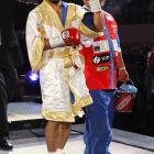 """The favored Pacquiao was all smiles during Saturday's ringwalk, coming out to AC/DC's """"Thunderstruck"""" and Joe Esposito's """"You're the Best"""" (from  The Karate Kid )."""