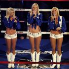 Three members of the Dallas Cowboys Cheerleaders sang the United States' national anthem before the pre-fight pomp.