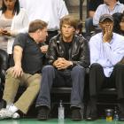 """Brady sits next to and Joe """"Jellybean"""" Bryant, father of Kobe, during last year's NBA Finals."""