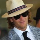 Fashion trendsetter Tom Brady hides his golden locks under a hat while attending  the 137th Kentucky Derby at Churchill Downs.