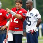 Brady and Chad Ochocinco talk strategy during training camp in July 2011. Ochocinco struggled with the Patriots, catching just 15 passes for 276 yards and a touchdown.