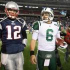 Brady and Mark Sanchez walk off the field after the Jets defeated the Patriots 28-21 in their 2011 AFC divisional playoff game at Gillette Stadium.