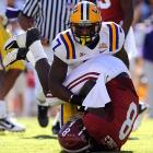 Alabama is no longer in the national championship discussion; LSU might have re-entered it. The Tigers used some trademark fourth-quarter trickery to put the nail in the Tide's coffin, setting up a huge score with a 23-yard reverse on fourth-and-one. But DeAngelo Peterson was far from the Tigers' only hero. Quarterback Jordan Jefferson and Jarrett Lee each made big plays late and defensive tackle Drake Nevis was a thorn in the side of Alabama's offense all game long.