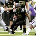 A week after wearing all white against USC, Oregon came out in all black against Washington -- and it was a dark start for the Ducks, who suffered their first scoreless quarter of the season. But the nation's No. 1 team overcame mistakes and penalties to outscore the Huskies 35-13 in the second half, thanks to a big day from LaMichael James, who ran for 121 yards and three scores.