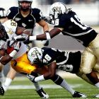 Central Florida's time in the Top 25 will be short lived. A week after gaining their first national ranking, the Knights surrendered four touchdowns to Eagles quarterback Austin Davis and managed just 21 points after averaging 41.4 during their previous five-game win streak.