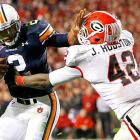 Another week, another win for Auburn, and another outstanding performance from Cam Newton even amid distraction. The star quarterback passed for 148 yards and two touchdowns and ran for 151 yards and two additional scores, leading Auburn to its 11th win of the season and the SEC West title.