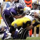 Northwestern's hold over Iowa continues. Last year, the Wildcats ended the Hawkeyes' perfect season. This year, Northwestern ended Iowa's outside shot at a Big Ten title. But it wasn't all good news for the 'Cats: Quarterback Dan Persa, who led Northwestern on two fourth-quarter touchdown drives, ruptured his Achilles tendon after throwing the winning score.