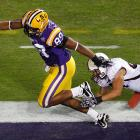LSU's defense did all the scoring the fifth-ranked Tigers needed against overmatched Louisiana-Monroe. Ron Brooks returned an interception for a touchdown, Lavar Edwards (left) brought back a fumble for another, and LSU's defense dominated. Josh Jasper added three field goals, including a 53-yarder, for the Tigers, who can finish its regular season 11-1 and earn an at-large bid to a BCS bowl.