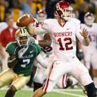 Landry Jones threw for 325 yards and three touchdowns with a 5-yard score to Ryan Broyles, who became the first Oklahoma receiver with a 100-catch season. DeMarco Murray turned a short pass into a long touchdown and ran for another score in the opening minutes as the Sooners kept their Big 12 title hopes alive. The Sooners play their regular season finale next Saturday at 12th-ranked Oklahoma State. The Bedlam rivalry could determine who will represent South Division in the league's last scheduled championship game, or could set up a three-way tie.