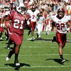 The Gamecocks wrapped up the SEC East title last week, but they didn't use that as an excuse to come out flat against Troy. Freshman sensation Marcus Lattimore rushed for three first-half touchdowns and South Carolina led 56-7 at the half en route to its highest points total under Steve Spurrier.