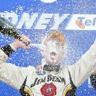 He coulda had a V8, but instead he fell for the old shaken bubbly gag after winning the V8 Supercar Championship in Sydney.