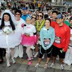 No better place to renew yer vows than Vegas, where folks often get hitched and wake up in the morning with no recollection. Here, TV personalities Molly Malaney ( third from right ) and Jason Mesnick ( second from right ) show you how its done at a touching ceremony during the big race.