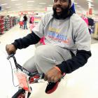 The Thunder shooting guard appears to have his eyes on next summer's Tour de France during a holiday shopping spree with families from the Grandparents Raising Grandchildren program in Oklahoma City.
