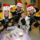 The three bears brought a little holiday cheer to a charming tot named Caleb at Children's Hospital Boston.