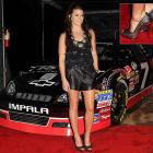 Auto racing's favorite siren unveiled what the well-dressed driver will be wearing behind the wheel next year as she rolled into the Auto Club Speedway and Tissot Event at Voyeur in Hollywood.
