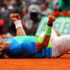 Spain's Rafael Nadal rolls around in the clay after winning the French Open at Roland Garros in Paris.  Nadal defeated Robin Soderling 6-4, 6-2, 6-4 to take home his fifth French Open title.