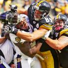 Pittsburgh Steelers tight end Matt Spaeth (89) lays a vicious block on Baltimore Ravens defensive end Terrell Suggs during the Ravens 17-14 victory.