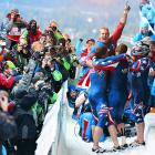 The U.S. bobsled team celebrates after winning gold in the four-man bobsled at the Winter Olympics.