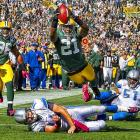 Green Bay cornerback Charles Woodson dives for a touchdown following an interception during the Packers' 28-26 victory over Detroit.