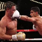 English boxer Amir Khan nails U.S. boxer Paulie Malignaggi with a left jab during the WBA light welterweight title fight at Madison Square Garden in New York City.  Khan would win in the 11th round on a TKO.