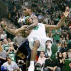 Rondo is tackled by Hawks forward Marvin Williams on a drive to the basket during Game 7 of their first-round playoff series. Williams was ejected on the play as the Celtics rolled to a 99-65 victory.
