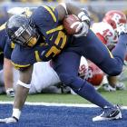 West Virginia did its part. Unfortunately for WVU, so did Connecticut. The Mountaineers (9-3, 5-2 Big East) secured a share of the Big East title with a 35-14 win over the struggling Scarlet Knights (4-8, 1-6), who surrendered a career-high 352 passing yards to Geno Smith and three rushing scores to Ryan Clarke. But UConn survived a Saturday night showdown with South Florida, earning the Big East's BCS berth due to its head-to-head win over WVU.
