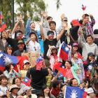 Spectators show their support for Yen-Hsun Lu of Taipei during his match against France's Gilles Simon.