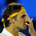 Federer reacts during a game against Djokovic.