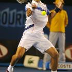 Novak Djokovic of Serbia returns to Roger Federer of Switzerland during their men's semifinal Thursday at Melbourne Park.