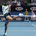 Li makes a backhand return to Wozniacki.
