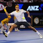 Federer returns to Djokovic during Thursday's match.
