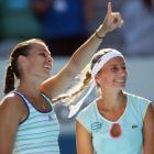 Pennetta (left) gives a thumbs-up sign to the crowd after Friday's victory. .