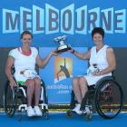 Esther Vergeer (left) and Sharon Walraven (right), both of the Netherlands, pose after winning the women's wheelchair doubles final against Dutch compatriots Aniek Van Koot and Jiske Griffioen.