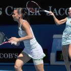 Gisela Dulko (right) of Argentina and Flavia Pennetta (left) of Italy play in the women's doubles final against Maria Kirilenko of Russia and Victoria Azarenka of Belarus.