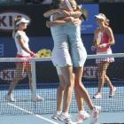 Dulko (right) and Pennetta (left) celebrate winning the women's doubles final.