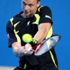 Robin Soderling of Sweden plays a backhand in his second-round match against Gilles Muller of Luxembourg. Soderling won 6-3, 7-6(1), 6-1.