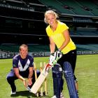 Caroline Wozniacki of Denmark prepares to play a shot as Australian cricketer Peter Siddle plays wicketkeeper during a cricket lesson from Australian cricketers Siddle and Aaron Finch at the Melbourne Cricket Ground.