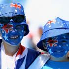 Young spectators at Melbourne Park show their support for the host country.