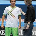 Dolgopolov is congratulated by two-time Australian Open champion and Channel 7 television commentator Jim Courier following his win over Soderling.