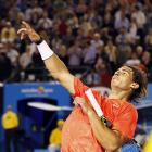 Rafael Nadal of Spain throws a wrist band to the spectators after his 6-2, 6-4, 6-3 win over Marin Cilic of Croatia.