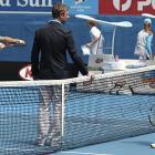 Switzerland's Roger Federer (right) and compatriot Stanislas Wawrinka (left) talk with chair umpire John Blom (center) before the start of their quarterfinal match.