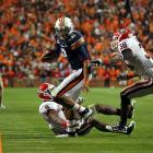 In another high-scoring affair, Auburn showed it had the offense to play with anyone in the nation.  The Tigers fell behind early and started the second half on the wrong side of a 21-7 score.  In the second half though, Cam Newton put the Tigers on his back and rallied his team to a 49-31 victory over Georgia.  In the process, Newton became only the eighth player in FBS history to throw for 2,000 yards and rush for 1,000 yards in a season.