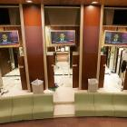 The two-story luxurious complex has a 60-inch plasma TV and smaller plasma screens scattered around the room for players to unwind.