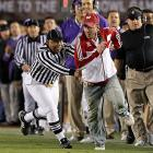 """Carried away by his zeal, a Wisconsin partisan decided to run an impromptu fly route at the Rose Bowl and was brought down by the referee. Where's Jets strength coach Sal """"Crazy Legs"""" Alosi when you need him?"""