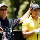Well aware of golf's tradition of dignity, the caddie (left) showed only the proper respect for his employer at the Joburg Open in Johannesburg, South Africa.