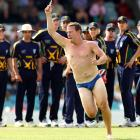 What the well-undressed pitch invader is wearing these days at tour matches between the Australian Prime Minister's XI and England in Canberra, Australia.